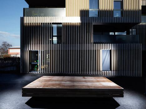 group8asia-travertino-strisce-strips-facciata-architettura-svizzera